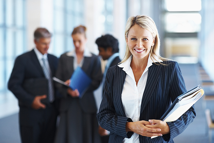 Cute business woman with colleagues in discussion at the background
