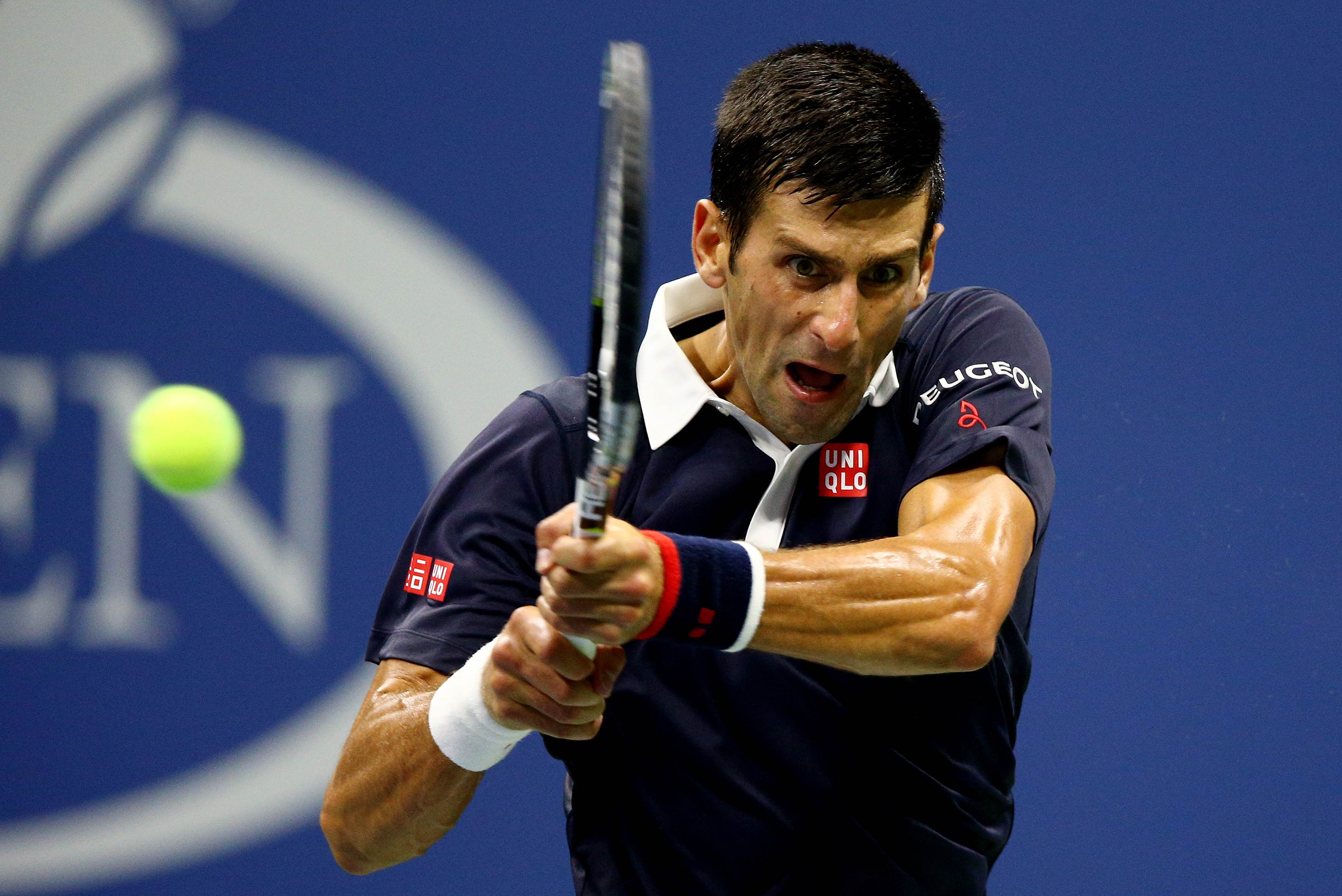 NEW YORK, NY - SEPTEMBER 08: Novak Djokovic of Serbia returns a shot to Feliciano Lopez of Spain during their Men's Singles Quarterfinals match on Day Nine of the 2015 US Open at the USTA Billie Jean King National Tennis Center on September 8, 2015 in the Flushing neighborhood of the Queens borough of New York City. Clive Brunskill/Getty Images/AFP == FOR NEWSPAPERS, INTERNET, TELCOS & TELEVISION USE ONLY ==