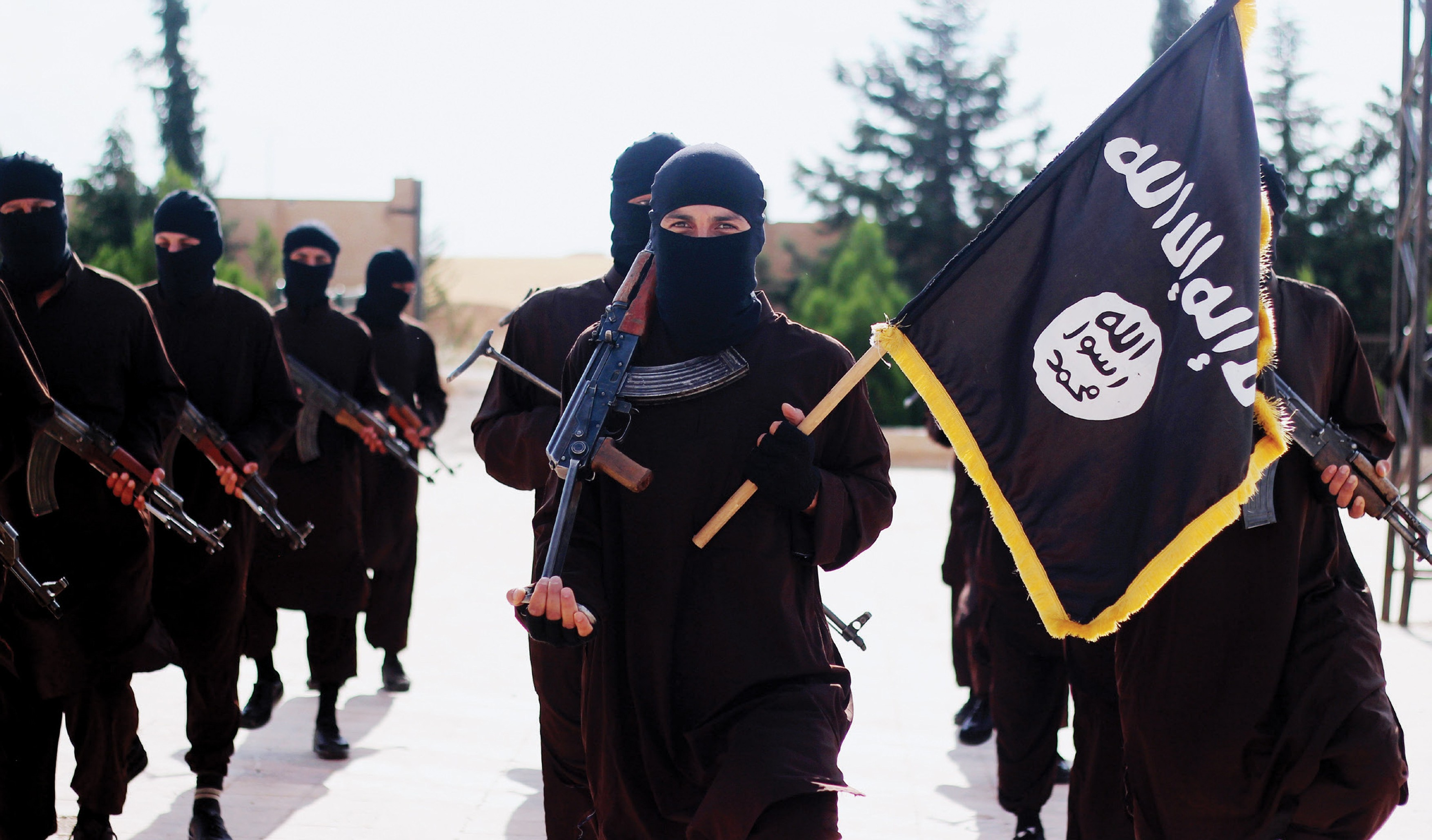Jan. 19, 2015 - Raqqua, Syria - Islamic State of Iraq and the Levant propaganda photo showing masked militants holding the ISIS black banner of Muhammad., Image: 266955336, License: Rights-managed, Restrictions: , Model Release: no, Credit line: Profimedia, Zuma Press - News