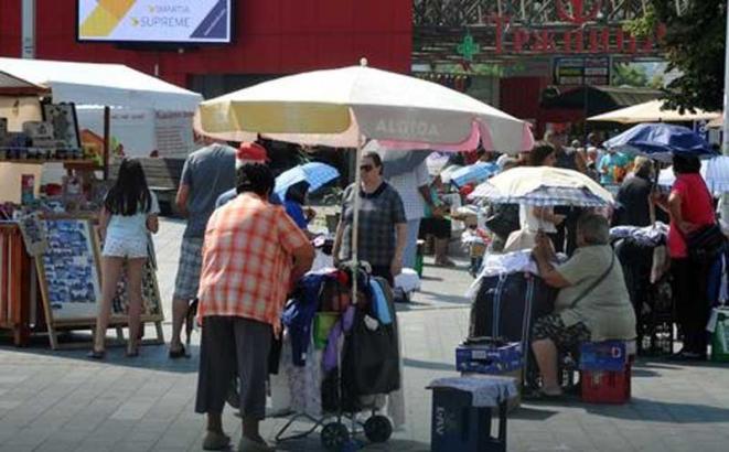 prodavci kisobrana trg