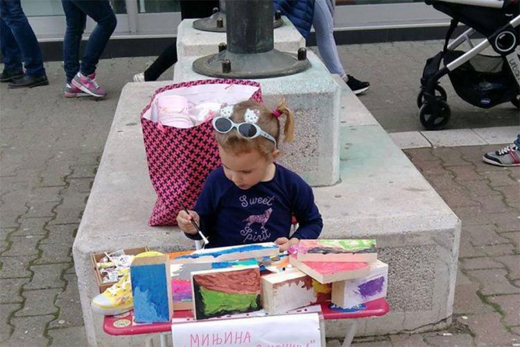 djevojcica prodaje slike